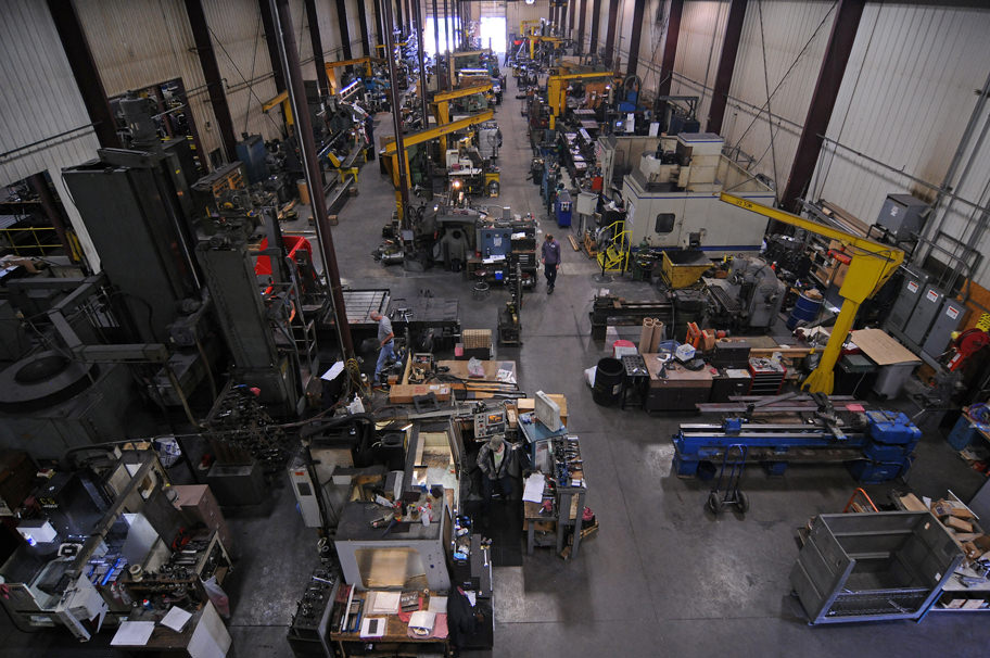 A high shot looking over workers and machines in the shop
